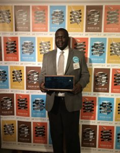 Image is of Willie Brake, Owner of All About Technology which is a Detroit based Minority and Disabled-Owned Business. Willie is proudly holding his award for business growth ideas.