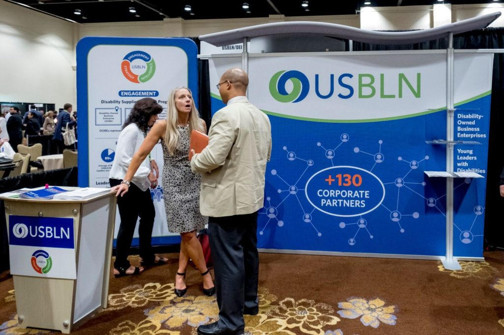 USBLN consultant Beth Butler chats with conference attendees about Going for the Gold.